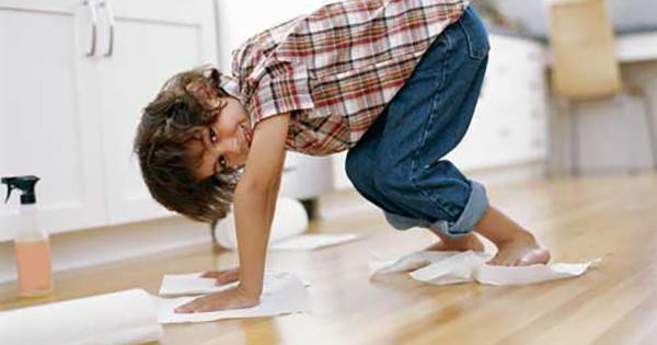 boy Cleaning hardwood floors