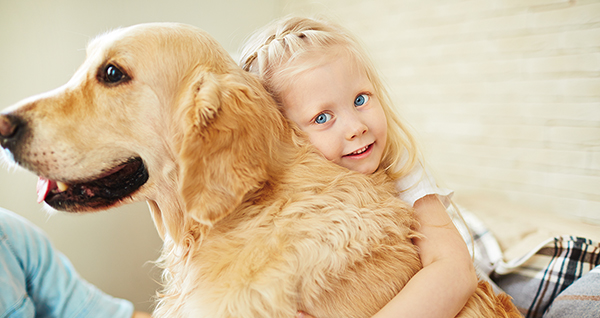 child with her pet dog