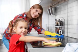 Mom and daughter cleaning together